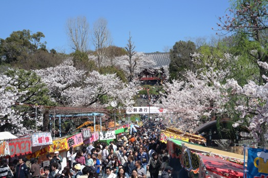The pathway leading to the island is lined with food stalls and thousands of people.